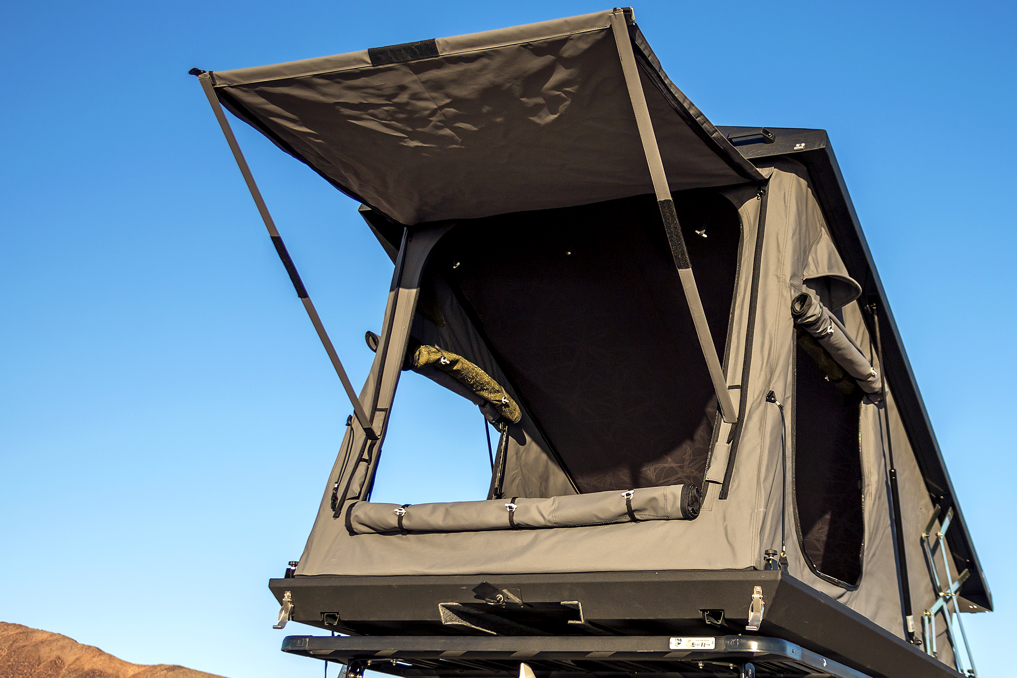Thick olive-drab privacy mesh screens adorn all three doors and canvas makes up the door panels themselves. Zippers are large and easy-moving as expected ... & Canvas meet Aluminum ? American Adventurist